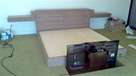 tv lift footboard black walnut king bed with 50 tv lift in footboard which