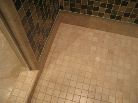 2x2 glass mosaic shower wall and 2x2 porcelain shower pan