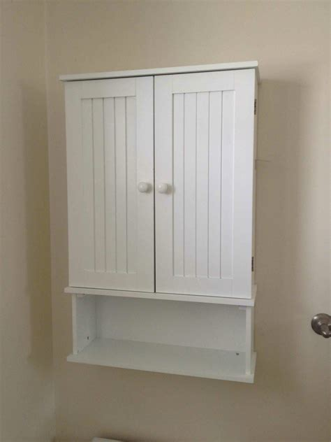 Small Wall Cabinets For Bathroom by Amazing White Wooden Door And Single Shelves Wall