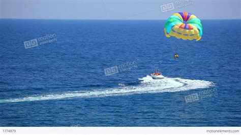 Motorboat Earth by Motorboat With Parachute Stock Footage 1774879