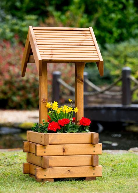 small wooden wishing  planter