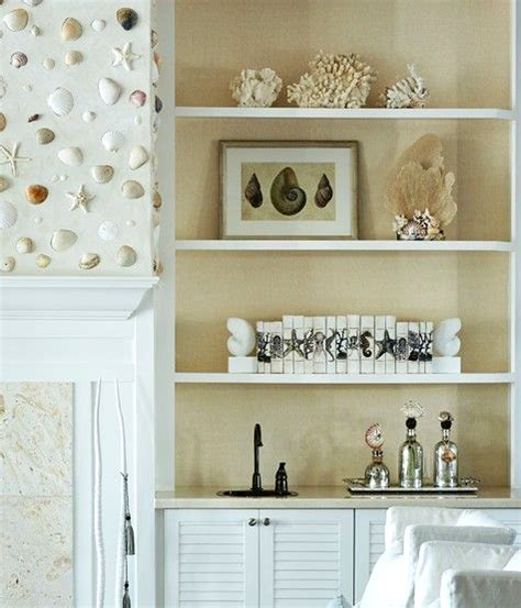 seashell room decor shell wall above fireplace in an elegant white coastal living room completely coastal