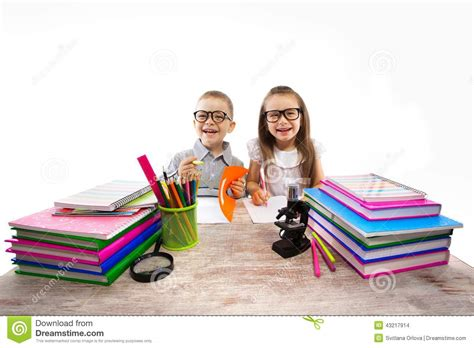 Two Kids At The Table Children Doing Homework Stock Photo