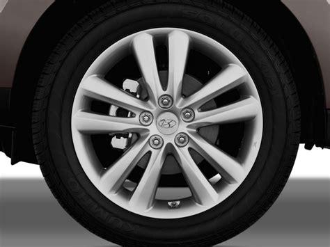 image  hyundai tucson fwd  door auto limited wheel cap size    type gif