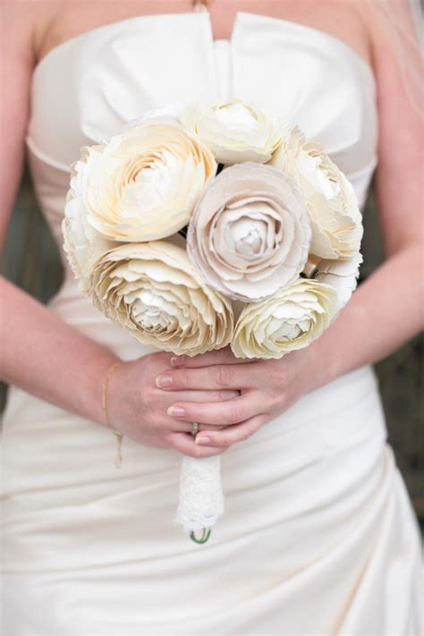 paper ranunculus bouquets and cake flowers emmaline