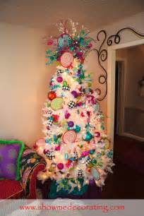 whitechristmas christmastree colorful ornaments and ribbon bring a touch of whimsy to this