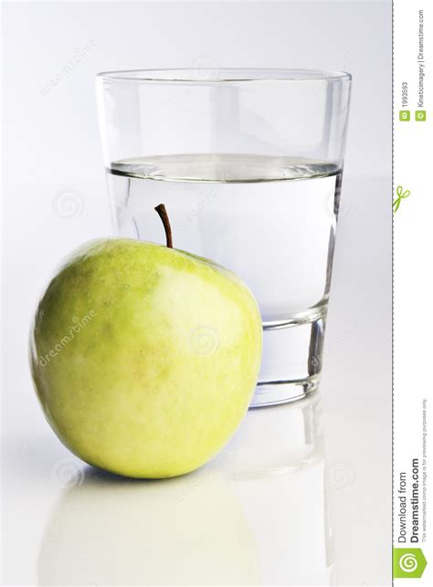 how much water is in an apple glass of water and green apple stock photos image 1993593
