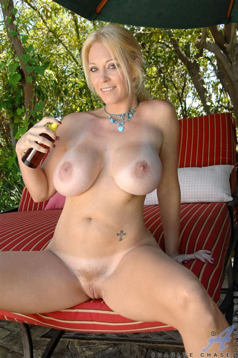 The Busty Milf Charlee Chase Is Outdoor Rubbing Toy Between Tits And Inside Pussy