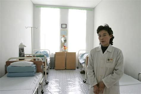 A North Korean nurse stands in a sickroom in a hospital in ...
