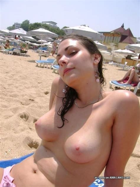 Gorgeous babe showing her tits outdoors