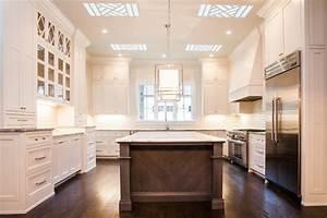 White Kitchen with Brown Island - Transitional - Kitchen