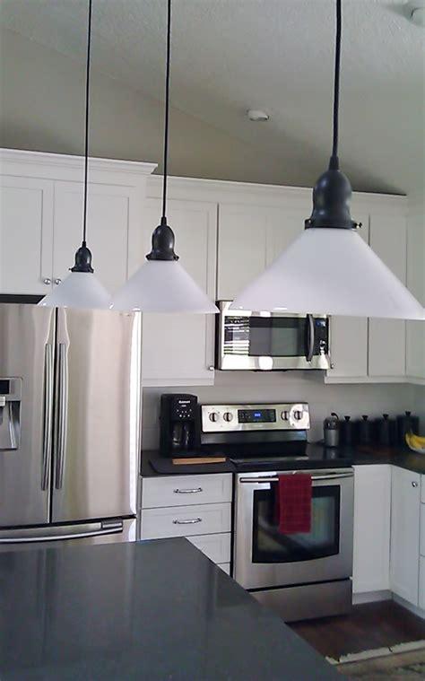 kitchen pendant lighting glass shades glass shade pendants bring vintage flavor to kitchen 8385
