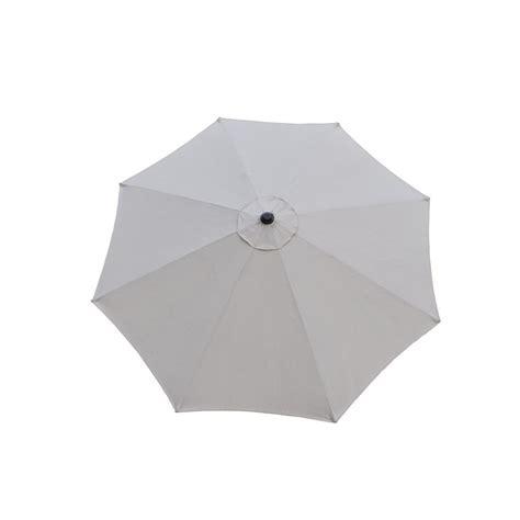 9 ft tilt patio umbrella in beige and cast poly resin