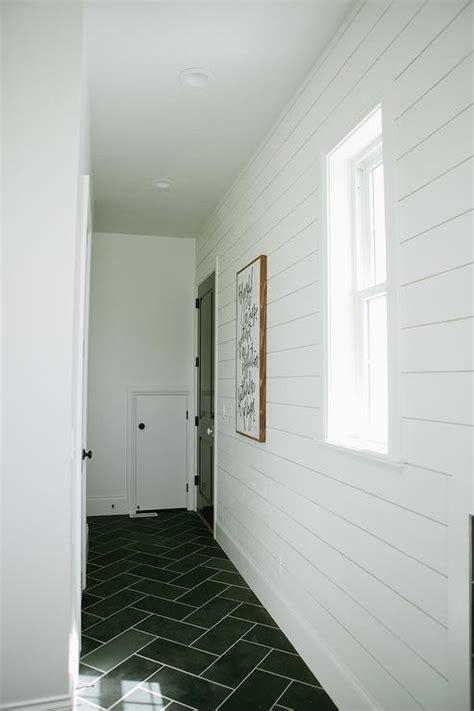 white shiplap mudroom  gray slate herringbone floor cottage laundry room