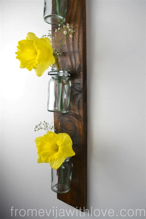 Hanging Wall Vase - a hanging wall vase from a pallet from evija with
