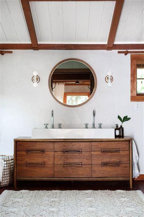 mid century modern sink vanity bathroom with a mid century sink vanity and round mirror