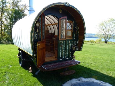 hand carved caravan  stained glass windows