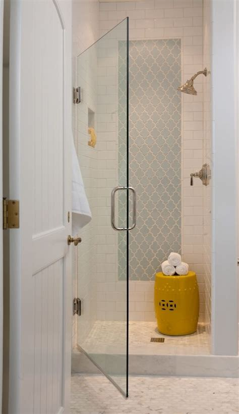 white subway tile with arabesque insert and marble mosaic