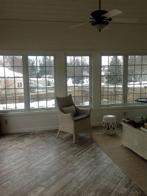 tile flooring for sunroom piano travertine sunroom floor the vein cut stone looks similar to a wood floor but this can