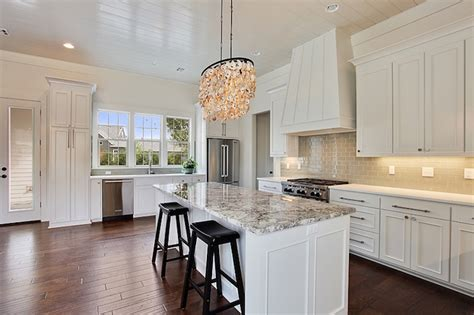 white kitchen island  gray granite countertops
