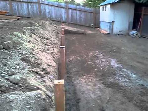 How To Level Your Backyard by Sloping Yard We Made To Levels An Put Wood Wall