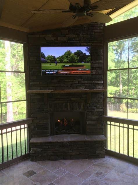 outdoor fireplace  screen porch  tv  eze breeze