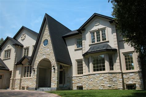 chateau home plans marriage of veneer and stucco finish