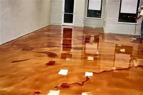 Metallic Epoxy Floor by This Pours A Buckets Of Metallic Epoxy What He
