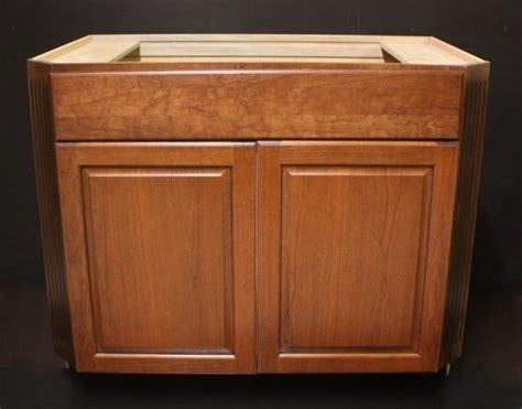 kitchen sink base cabinet kraftmaid praline w onyx glaze cherry kitchen sink base 5640
