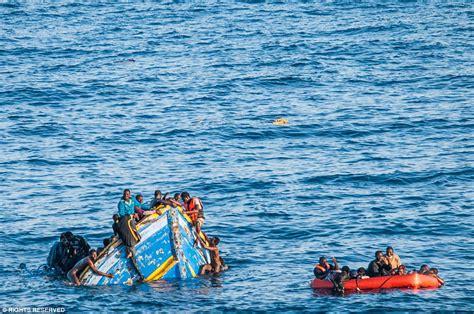 Boat Sinking Libya by Mediterranean Migrants Libyan Coast Cling Onto Sinking