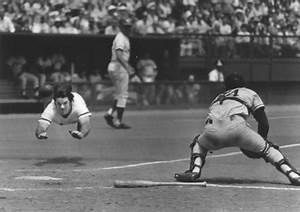 Attempting To Slide Like Pete Rose During A Softball Game
