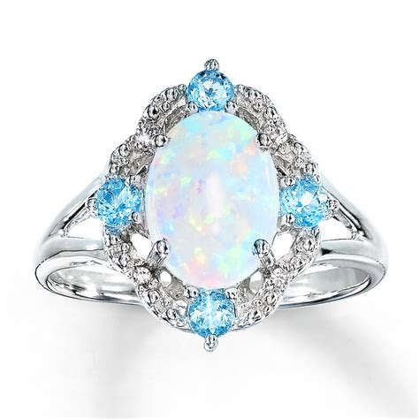 Opel Ring by Lab Created Opal Ring Blue Topaz Diamonds Sterling