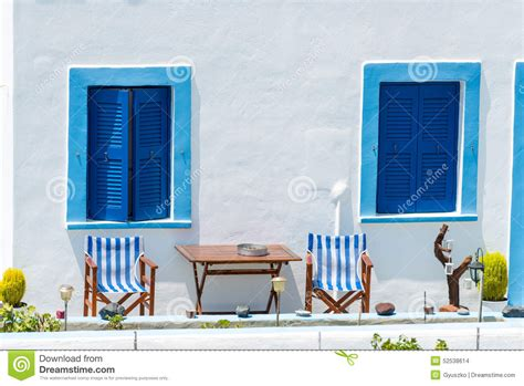 blue windows   white building  oia santorini stock
