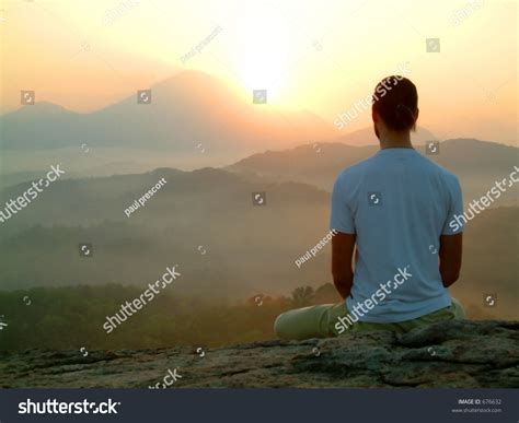 Man Meditating At Sunrise Stock Photo 676632