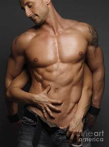 Woman Touching Muscular Man's Body Photograph by Maxim Images