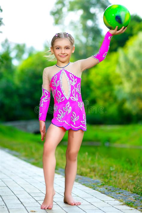 outdoor portrait  young cute  girl gymnast stock