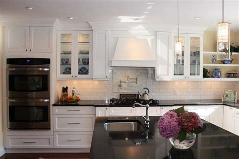 love  shaker style white cabinets black granite