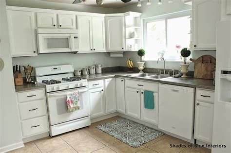 timid white kitchen cabinets makeover monday i painted my kitchen cabinets shades 6246