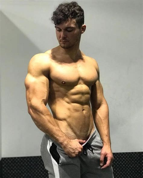 Josh Watson posing shirtless for a photo looking muscular ...