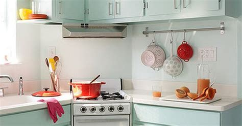 colored cabinets in kitchen mint green retro inspired kitchen the white counters and 8555