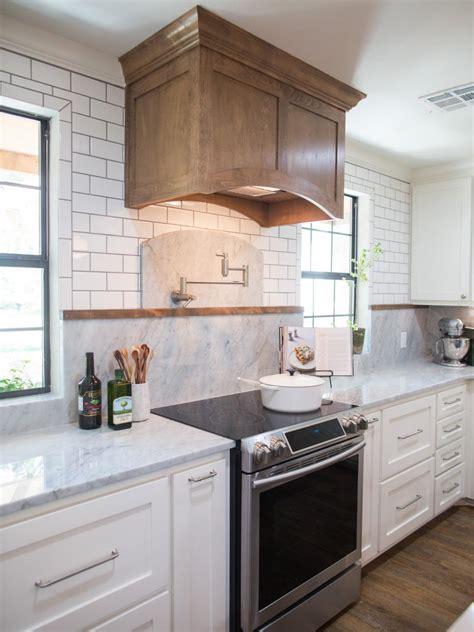contemporary white kitchen  wood range hood hgtv