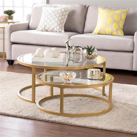 This round coffee table has a glam, mid century modern feel that will complement your current home décor. Gold Opaline Nesting Coffee Table