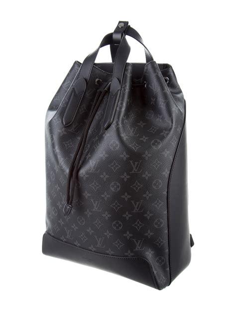 louis vuitton  monogram eclipse explorer backpack bags lou  realreal