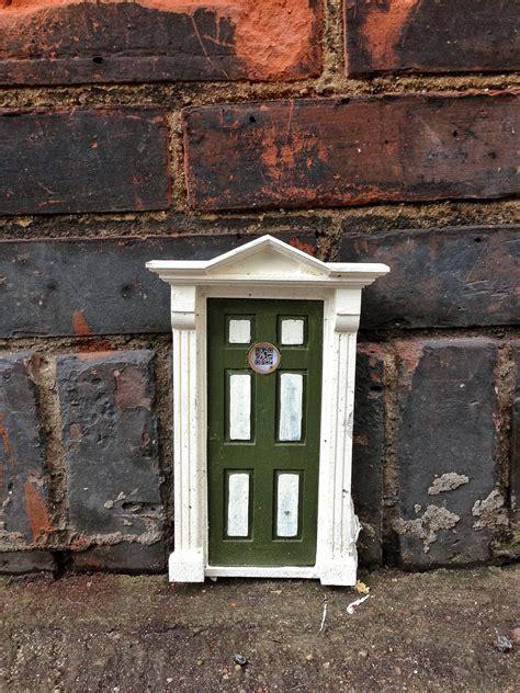 tiny door   street bryan thatcher