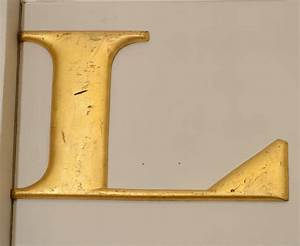 two vintage woolworth quotlquot and quotoquot gilded cast iron letters With cast iron letters