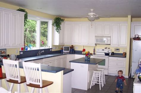 pictures of kitchens with yellow walls white cabinets and