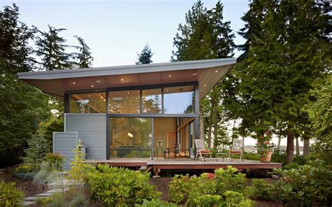 modern waterfront house with high glass walls modern