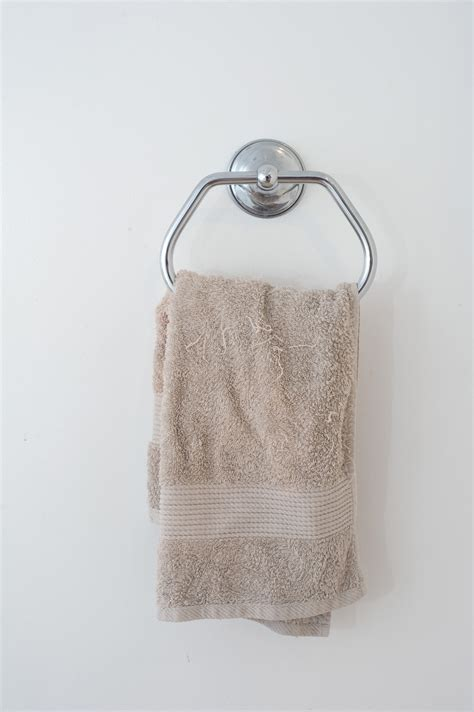 Towels Hanging In Bathroom Stock Free Stock Photo 6923 Beige Towel Hanging In A