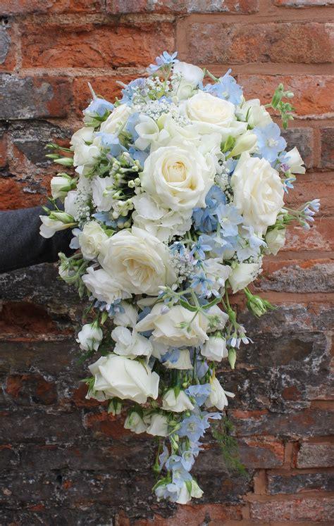 cascading bridal bouquet  pale blue  ivory flowers