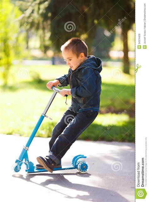 boy riding  scooter  park royalty  stock